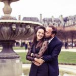 couple-kissing-near-fountain