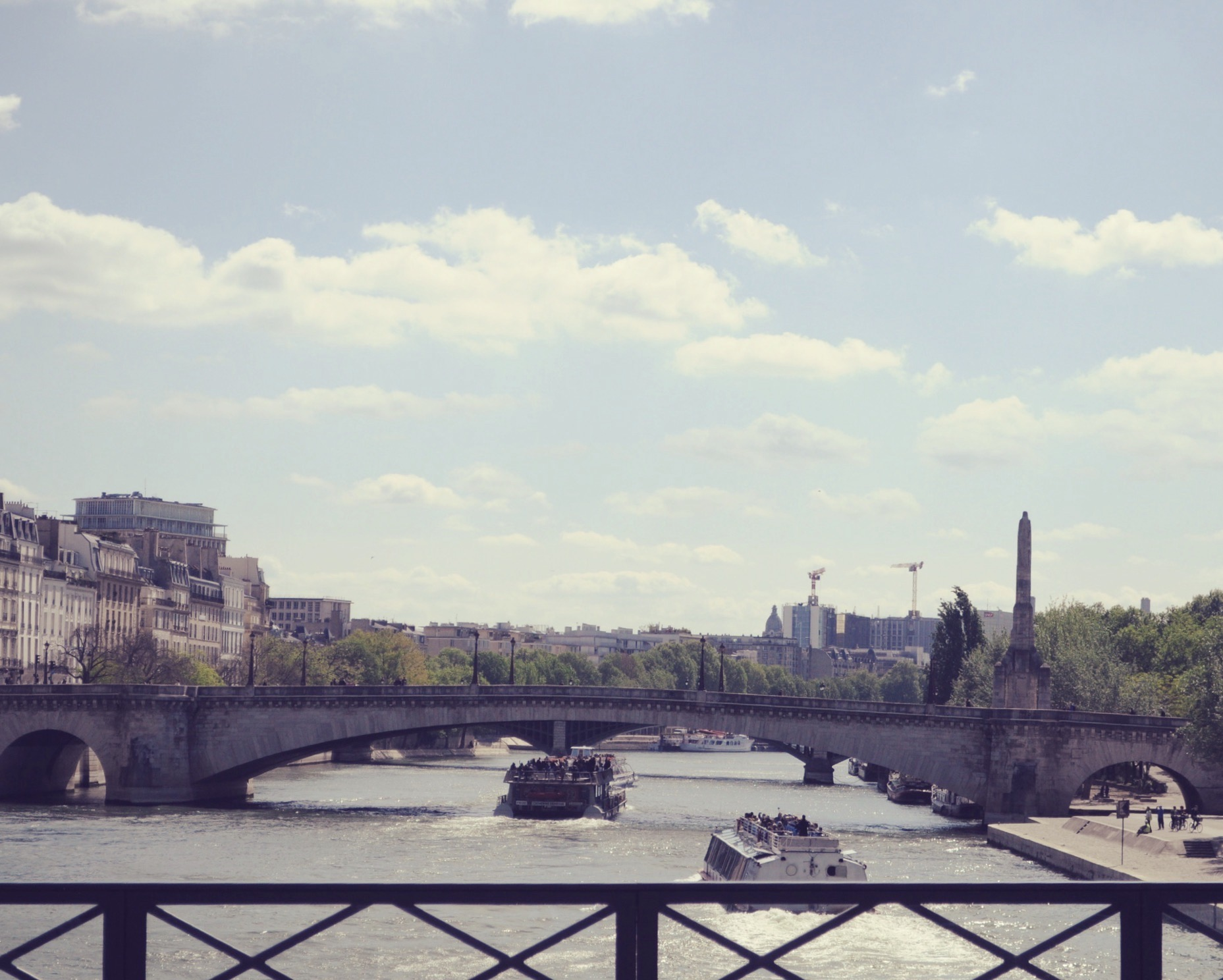 river-seine-Paris-overlooking-bridge-Celine-Concierge