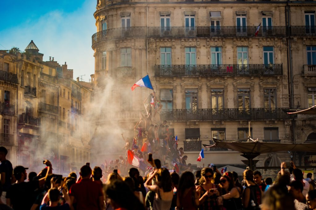 crowd-in-Paris-celebrating-with-French-Flag